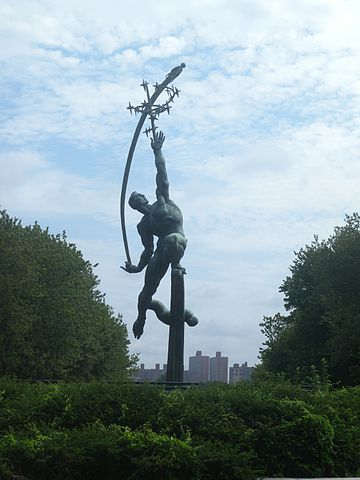 Statue of man throwing rocket to the stars